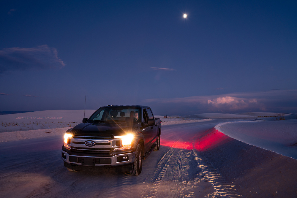 In amongst gypsum dunes that cover 1000s of acres, a lightning storm illuminates the centre of the large cloud over huge mountain ranges in Southern New Mexico. A 3/4 moon hangs silently between the thunder claps and our friend & tour guide Carole waits patiently in her powerful 4x4 for me to finish. I loved the atmosphere, the range of illumination and the surreal fake snow landscape! The lightning storm lasted for over an hour and 6 fighter jets from the nearby Almagordo Air Base blasted overhead into the night sky.