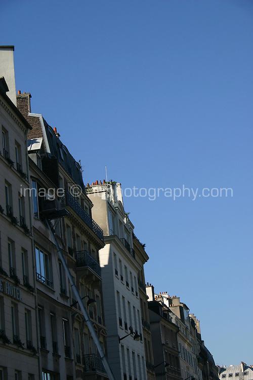 Furniture being raised to upper floor by lift in St-Germain, Paris, France<br />