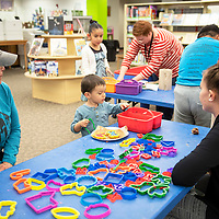 Oskar Schieldrop, 2, makes his own seed bombs using recycled paper, Saturday, April 20 at the children's library in Gallup.