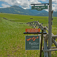 A real estate sign advertises a pasture for sale in Montana's Gallatin Valley, near Bozeman. Mount Ellis and the southern Gallatin Range rise in the background.