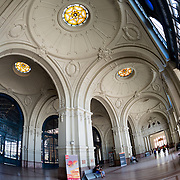 The main entrance to Estacion Mapocho (Mapocho Station) in downtown Chile. Once Santiago's main train station, it was no longer used and left abandoned before being restored and is now used as a public convention and concert space. The opulent building dates to 1912.