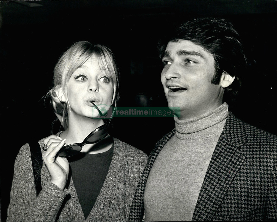 """Jan. 29, 1970 - January 29th, 1970 Goldie Hawn arrives – Goldie Hawn, the kooky blonde of the American TV show, The Rowan and Martin Laugh-in seen on British TV, arrived at Heathrow Airport today. Tonight she will be one of the leading guests at the premiere in London's West End, of the film """"Marooned"""", which stars Gregory Peck. Goldie has made her first film """"Cactus Flower"""", and her second """"There's a Girl in My Soup"""" will be made in Britain. Photo Shows: Goldie Hawn pictured on her arrival at Heathrow Airport, with her husband, Gus Trekonis. (Credit Image: © Keystone Press Agency/Keystone USA via ZUMAPRESS.com)"""