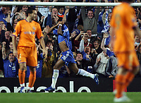 Photo: Paul Thomas.<br /> Chelsea v Barcelona. UEFA Champions League, Group A. 18/10/2006.<br /> <br /> Didier Drogba of Chelsea celebrates his goal.
