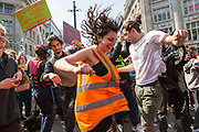 Protestors dance during a performance by Electro duo The Correspondents during a protest against climate change in the middle of Oxford Circus on 15th April, 2019 in London, United Kingdom.  Extinction Rebellion have blocked five central London landmarks in protest against government inaction on climate change. .