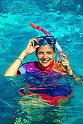 Woman enjoying snorkeling, Belize
