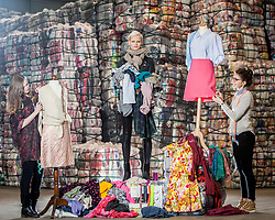 Students Lucu Morrant and Hannah McKinnon with model Anna Freemantle, showing fashion students about upcycling clothes, at the UK's second largest textile recycling facility, Nathan's Wastesavers, in Denny.<br /> © Michael Schofield.