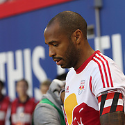 Thierry Henry, New York Red Bulls, leads the team out during the New York Red Bulls Vs Houston Dynamo, Major League Soccer regular season match at Red Bull Arena, Harrison, New Jersey. USA. 4th October 2014. Photo Tim Clayton