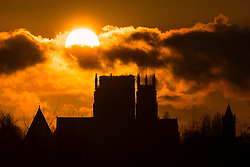 © Licensed to London News Pictures. 20/03/2020. York UK. The sun breaks through the clouds as it rises this morning above York Minster in Yorkshire, on the spring equinox. Today is the earliest March equinox in 124 years with the last one being in 1896. The Minster closed its door's to the public earlier this week due the COVID 19 outbreak. Photo credit: Andrew McCaren/LNP