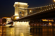 Chain Bridge or lanchid crossing the river Danube in Budapest at night .<br /> <br /> Visit our HUNGARY HISTORIC PLACES PHOTO COLLECTIONS for more photos to download or buy as wall art prints https://funkystock.photoshelter.com/gallery-collection/Pictures-Images-of-Hungary-Photos-of-Hungarian-Historic-Landmark-Sites/C0000Te8AnPgxjRg