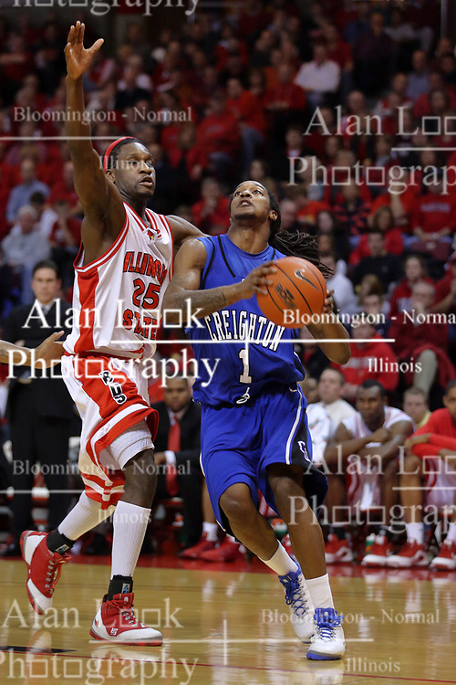 03 January 2009: Justin Carter rushes the baseline with his eye on the hoop passing Champ Oguchi. The Illinois State University Redbirds extended their record to 14-0 with a 86-64 win over the Creighton Bluejays on Doug Collins Court inside Redbird Arena on the campus of Illinois State University in Normal Illinois