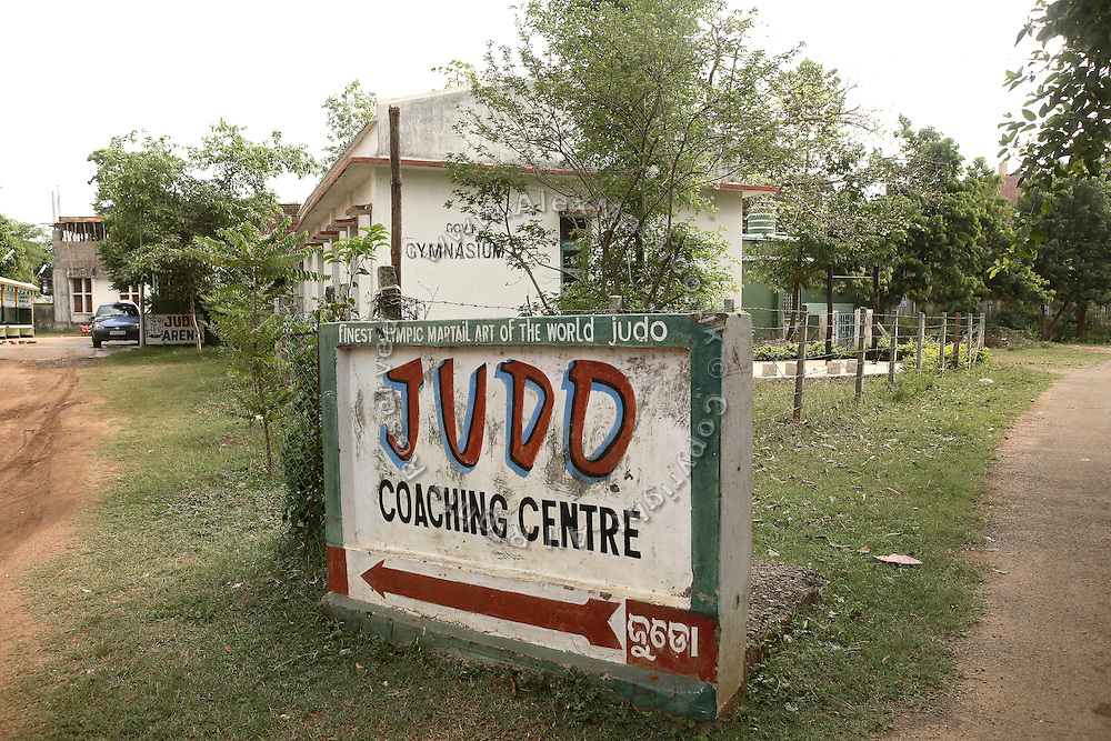 The road leading to Biranchi Das Judo Hall is photographerd in Bhubaneswar, the capital of Orissa State, on Saturday, May 17, 2008. On May 1, 2006, Budhia completed a record breaking 65 km run from Jagannath temple, Puri to Bhubaneswar. He was accompanied by his coach Biranchi Das and by the Central Reserve Police Force (CRPF). On 8th May 2006, a Government statement had ordered that he stopped running. The announcement came after doctors found the boy had high blood pressure and cardiological stress. As of 13th August 2007 Budhia's coach Biranchi Das was arrested by Indian police on suspicion of torture. Singh has accused his coach of beating him and withholding food. Das says Singh's family are making up charges as a result of a few petty rows. On April 13, Biranchi Das was shot dead in Bhubaneswar, in what is believed to be an event unconnected with Budhia, although the police is investigating the case and has made an arrest, a local goon named Raja Archary, which is now in police custody. **Italy and China Out**