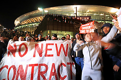 Arsenal supporters protest outside of the Emirates Stadium