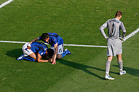 Photo: Glyn Thomas.<br />Italy v Australia. 2nd Round, FIFA World Cup 2006. 26/06/2006.<br /> Italy's Fabio Grosso (L) and Vincenzo Iaquinta (C) celebrate winning a last minute penalty as Australia's goalkeeper Mark Schwarzer looks dejected.