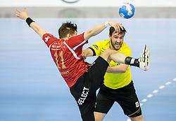 Roman Sidorowicz of Winterthur vs Senjamin Buric of RK Gorenje during handball match between RK Gorenje Velenje (SLO) and Pfadi Winterthur (SUI) in Group Phase of EHF European Cup 2014/15, on March 8, 2015 in Rdeca dvorana, Velenje, Slovenia. Photo by Vid Ponikvar / Sportida