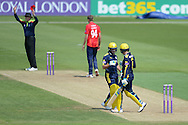Umpire Bailey signals a 6 of the final over of Hampshires innings Hampshire all-rounder Liam Dawson and Will Smith during the Royal London One Day Cup match between Hampshire County Cricket Club and Essex County Cricket Club at the Ageas Bowl, Southampton, United Kingdom on 5 June 2016. Photo by David Vokes.