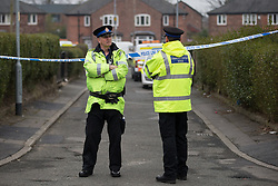 © Licensed to London News Pictures . 28/03/2014 . Manchester , UK . Police and forensic scenes of crime officers on the scene at Borland Avenue , Moston , where it is reported a man was shot in the leg this afternoon (Friday 28th March 2014) . Photo credit : Joel Goodman/LNP