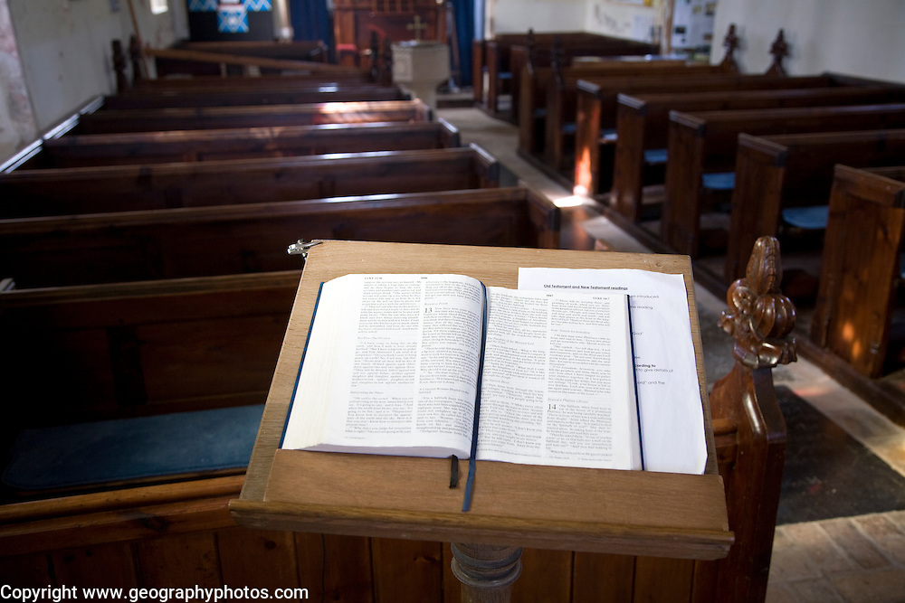 Open bible book on lectern in small empty church All Saints and St Margaret's church, Chattisham, Suffolk