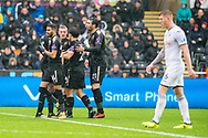 Riyad Mahrez (l) and his Leicester City teammates celebrate after their 1st goal, a Mahrez shot deflected in off Fernando Fernandez of Swansea.Premier league match, Swansea city v Leicester city at the Liberty Stadium in Swansea, South Wales on Saturday 21st October 2017.<br /> pic by Aled Llywelyn, Andrew Orchard sports photography.