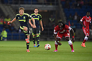Adam Clayton of Middlesbrough (l) is watched closely by Kenwyne Jones of Cardiff. Skybet football league championship match, Cardiff city v Middlesbrough at the Cardiff city stadium in Cardiff, South Wales on Tuesday 16th Sept 2014<br /> pic by Andrew Orchard, Andrew Orchard sports photography.