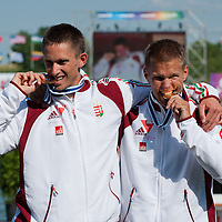 David Toth (R) and Tamas Kulifai (R) from Hungary celebrate their victory in the K2 men Kayak 500m final of the 2011 ICF World Canoe Sprint Championships held in Szeged, Hungary on August 20, 2011. ATTILA VOLGYI