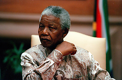 NELSON ROLIHLAHLA MANDELA (July 18, 1918 - December 5, 2013) world renowned civil rights activist and world leader dies at 95. Mandela emerged from prison to become the first black President of South Africa in 1994. As a symbol of peacemaking, he won the 1993 Nobel Peace Prize. Joined his countries anti-apartheid movement in his 20s and then the ANC (African National Congress) in 1942. For next 20 years, he directed a campaign of peaceful, non-violent defiance against the South African government and its racist policies and for his efforts was incarcerated for 27 years. PICTURED: Oct 5, 1996 - South Africa - President NELSON MANDELA. (Credit Image: © Aftonbladet/IBL/ZUMAPRESS.com)