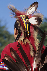 North America, USA, Washington, Seattle. Native American in traditional head dress and eagle feather bustle