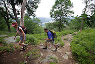 Bear Mountain, New York - A woman and a man hike up the Appalachian Trail at Bear Mountain on June 5, 2010. The Hudson River is visible in the background.