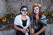 Young women dressed as La Calavera Catrina during the final day of the Day of the Dead festival November 2, 2016 in San Miguel de Allende, Guanajuato, Mexico. The week-long celebration is a time when Mexicans welcome the dead back to earth for a visit and celebrate life.