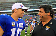 New York Giants quarterback Eli Manning (10) talks during postgame to FOX Sports sideline reporter Tony Siragusa during the NFL regular season week 1 football game against the Carolina Panthers on Sunday, September 12, 2010 in East Rutherford, New Jersey. The Giants won the game 31-18. ©Paul Anthony Spinelli