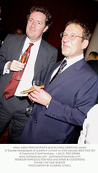 Mirror editor PIERS MORGAN and RICHARD DESMOND owner of Express Newspapers at a party in London on 23rd January 2003.PGO 351