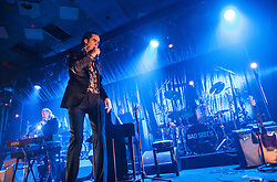 A wide angle shot of Nick Cave on the stage, Nick Cave and the Bad Seeds, on stage tonight at The Barrowlands, Glasgow, Scotland.<br /> ©Michael Schofield.
