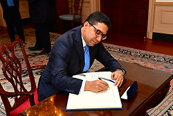 Moroccan Foreign Minister Nasser Bourita signs U.S. Secretary of State Rex Tillerson's guestbook before their meeting at the U.S. Department of State in Washington, D.C. on September 7, 2017. (Photo by State Department Photo)  Please note: Fees charged by the agency are for the agency's services only, and do not, nor are they intended to, convey to the user any ownership of Copyright or License in the material. The agency does not claim any ownership including but not limited to Copyright or License in the attached material. By publishing this material you expressly agree to indemnify and to hold the agency and its directors, shareholders and employees harmless from any loss, claims, damages, demands, expenses (including legal fees), or any causes of action or allegation against the agency arising out of or connected in any way with publication of the material.