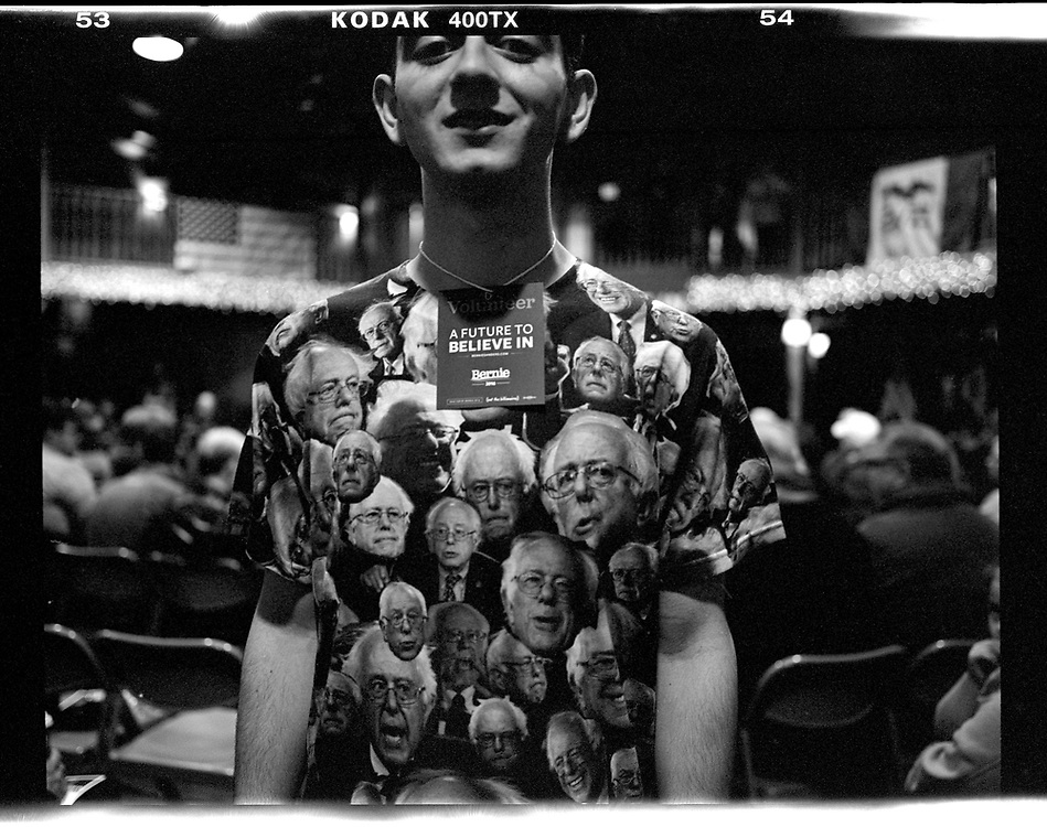 A volunteer at a U.S. Democratic presidential candidate Bernie Sanders' campaign event wears a shirt decorated with Sanders' image in Fort Dodge, Iowa. © Photo by Jim Young