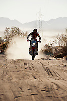 5x Honda motorcyle of Francisco Arredondo passes race mile 58 in 2012 San Felipe Baja 250, San Felipe, Baja California, Mexico.
