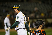 Oakland Athletics designated hitter Ryon Healy (25) reacts to a called strike against the Miami Marlins at Oakland Coliseum in Oakland, Calif., on May 23, 2017. (Stan Olszewski/Special to S.F. Examiner)