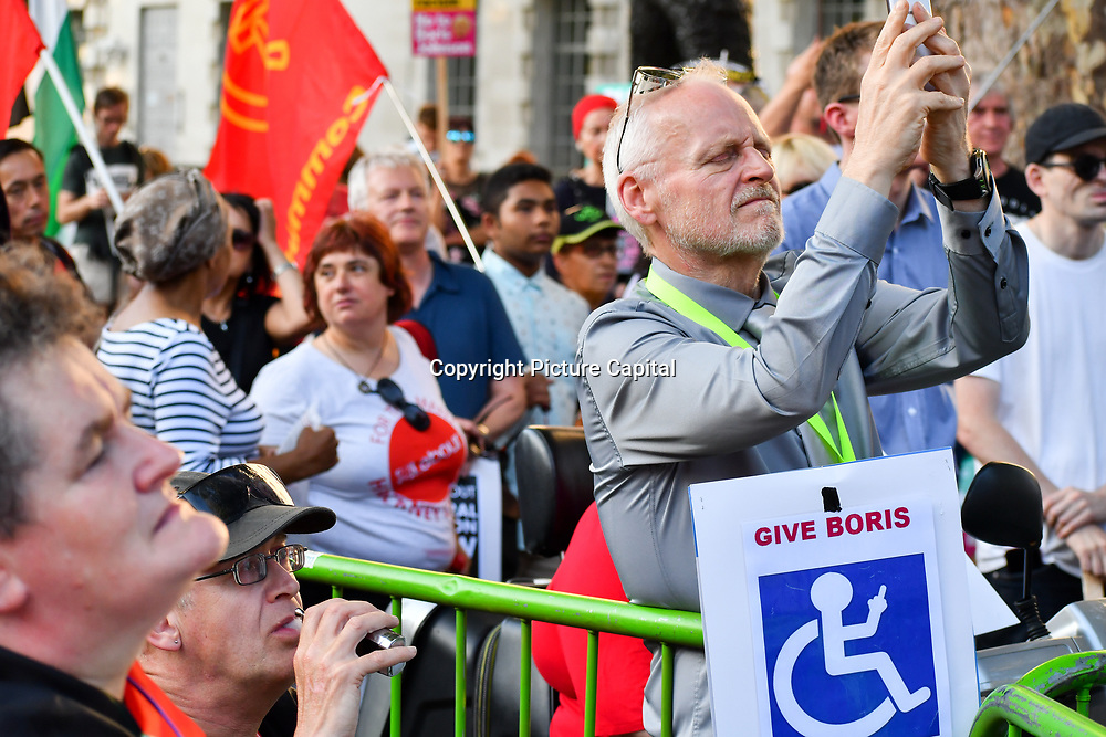 Hundreds attend Rally: Not My Prime Minister-General Election Now opposite Downing Street, hosted by The People's Assembly Against Austerity and Stop the War on 22 July 2019, London, UK.