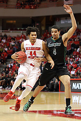 18 March 2015:  DeVaughn Akoon-Purcell takes a little hop to pass Jordan Fouse on his way to the hoop  during an NIT men's basketball game between the Green Bay Phoenix and the Illinois State Redbirds at Redbird Arena in Normal Illinois