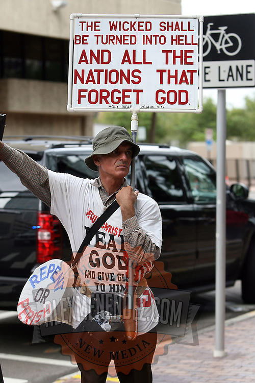 A Bible Believers member holds up a sign during the Republican National Convention in Tampa, Fla. on Wednesday, August 29, 2012. (AP Photo/Alex Menendez)