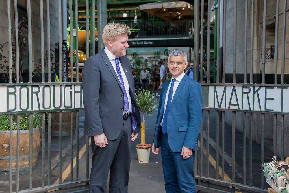 The Mayor Sadiq Khan arrives and is greeted by market officials at teh main gate - The market reopening is signified by the ringing of the bell and is attended by Mayor Sadiq Khan. Tourists and locals soon flood back to bring the area back to life. London 14 Jun 2017