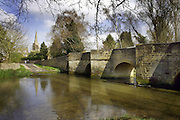 The river Ise Ford in the village of Geddington, Northamptonshire.<br /> Geddington was one of the stopping points for the funeral cortège of Queen Eleanor and the village is home to an intact and original Eleanor Cross.