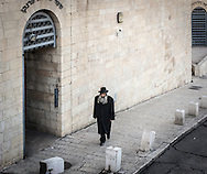 """A jewish man with long beard and curls (payot) walks in Jerusalem Old City toward King David's tomb sited on Mount Zion. Payot are worn based on an interpretation of the Biblical injunction against shaving the """"corners"""" of one's head. David is an important figure in Judaism (and also Islam for which is a prophet, and Christianity who considers him an ancestor of Jesus). Historically, David's reign represented the formation of a coherent Jewish kingdom centered in Jerusalem. David is an important figure within the context of Jewish messianism. In the Hebrew Bible, it is written that a human descendant of David will occupy the throne of a restored kingdom and usher in a messianic age."""