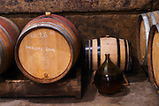 Barrels of different size and a glass demi-john in the wine cellar. Domaine Viret, Saint Maurice sur Eygues, Drôme Drome France, Europe