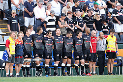 Sharks bench during the minutes silence for the earthquake victims in Christchurch, New Zealand during the Super15 match between The Mr Price Sharks and The Blues held at Mr Price Kings Park Stadium in Durban on the 26th February 2011..Photo By:  Ron Gaunt/SPORTZPICS