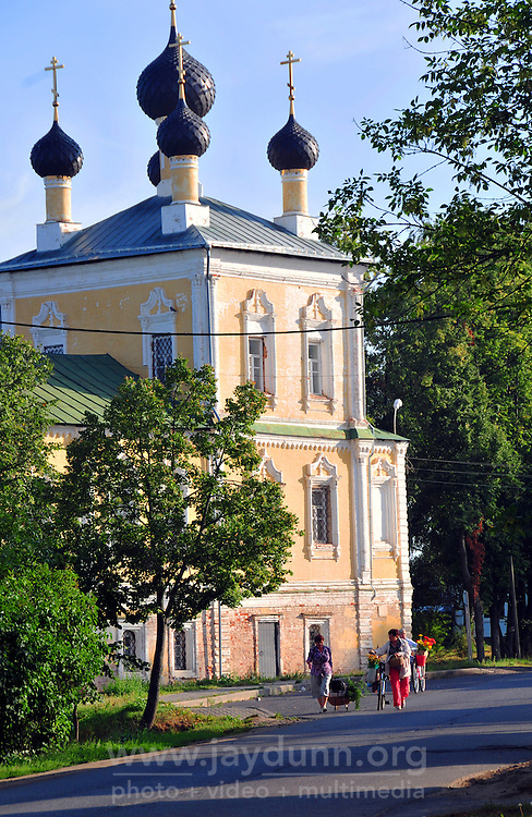 """Women walk past the Voskreseniia church on their way to market in Uglich, Russia. As one of Russia's """"Golden Ring"""" cities, Uglich is designated a town of significant cultural importance."""