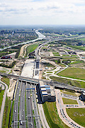Nederland, Utrecht, Utrecht, 09-04-2014; Rijksweg A2 en de noordelijke ingang van de Leidsche Rijntunnel, een landtunnel die de verkeersoverlast, luchtvervuiling en geluidsoverlast voor Utrecht en de Vinexwijk Leidsche Rijn moet verminderen. Direct na de spoorlijn is het betonnen dak van de tunnel zichtbaar, hier moet een park op komen.<br /> Links het Amsterdam-Rijnkanaal met de stad Utrecht. <br /> Roadway A2 and the southern entrance to the tunnel Leidsche Rijn, a landtunnel built to decrease the nuisance of traffic noise and air pollution for the city of Utrecht and the suburb Leidsche Rijn . Right the Amsterdam-Rhine Canal and the city of Utrecht.<br /> luchtfoto (toeslag op standaard tarieven); aerial photo (additional fee required); copyright foto/photo Siebe Swart.