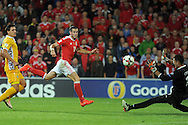 Gareth Bale of Wales (red) scores his teams 3rd goal past Moldovan goal keeper  Ilie Cebanu (r). Wales v Moldova , FIFA World Cup qualifier at the Cardiff city Stadium in Cardiff on Monday 5th Sept 2016. pic by Carl Robertson, Andrew Orchard sports photography