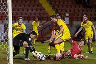 Walsall goalkeeper Liam Roberts (#1) collects the ball in a goalmouth scramble during the EFL Sky Bet League 2 match between Crawley Town and Walsall at The People's Pension Stadium, Crawley, England on 16 March 2021.