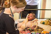 Dr Siobhan Neville examines 1 month old Sharifo on the NICU (Neonatal Intensive Care Unit) Ward. St Walburg's Hospital, Nyangao. Lindi Region, Tanzania.