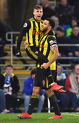 Watford's Gerard Deulofeu (left) celebrates scoring his side's second goal of the game with team-mate Troy Deeney during the Premier League match at the Cardiff City Stadium.
