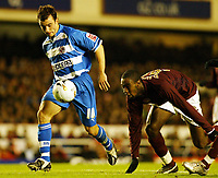 Photo: Chris Ratcliffe.<br /> Arsenal v Reading. Carling Cup. 29/11/2005.<br /> John Oster of \Reading gets away from Johan Djourou of Arsenal